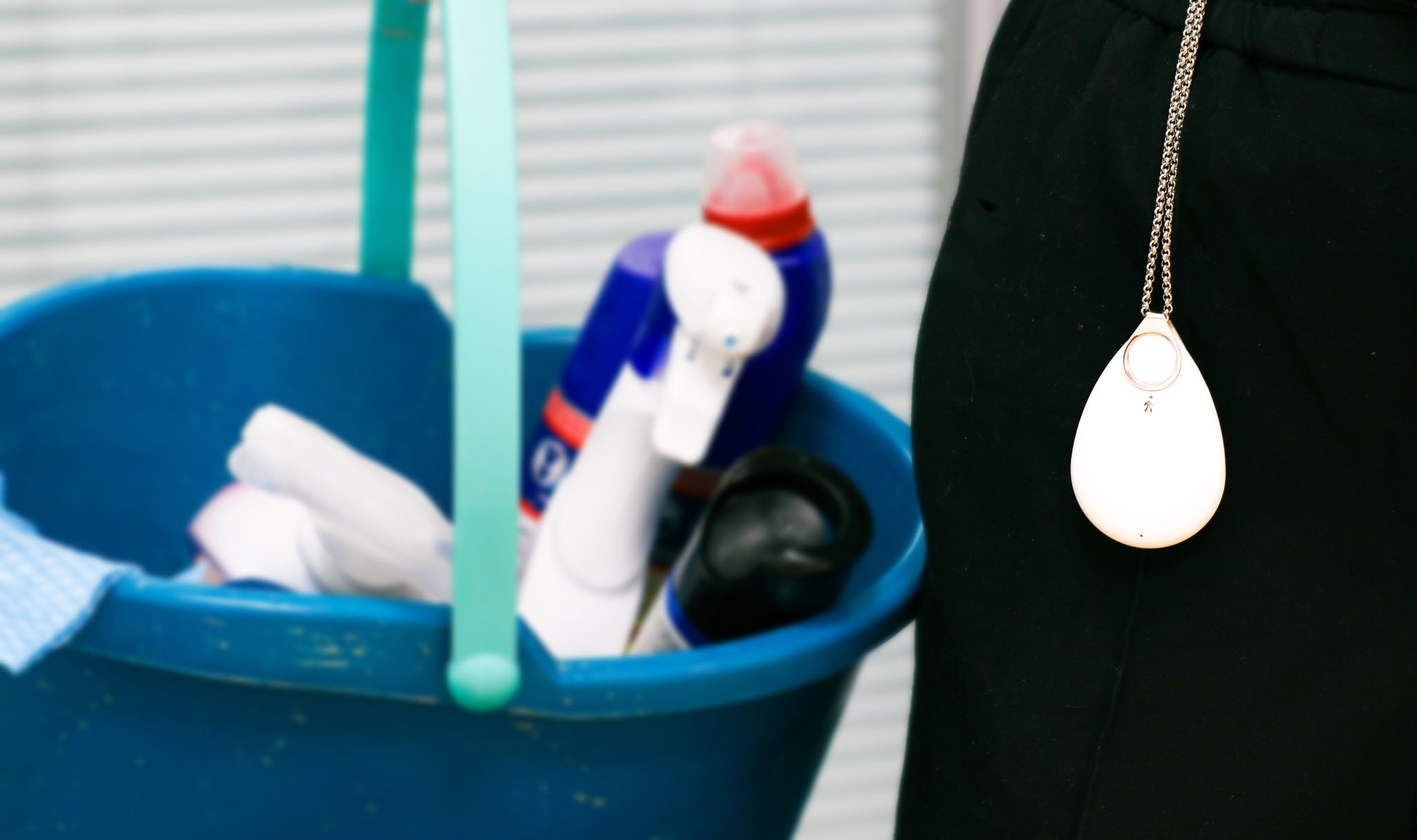 Cleaner wearing Lone Alarm