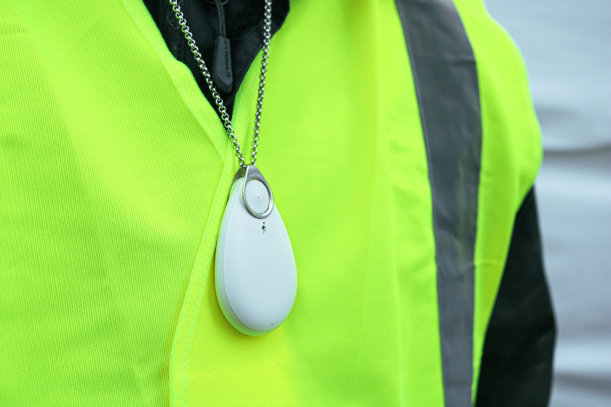 lone worker in hi-vis jacket wearing a Lone Alarm around their neck