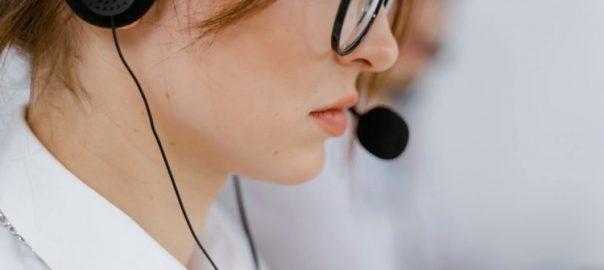 Office worker wearing phone headset