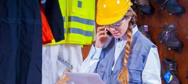 Worker wearing hard hat and talking on mobile phone