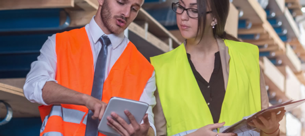 One male and one female worker, both in high-visibility jackets
