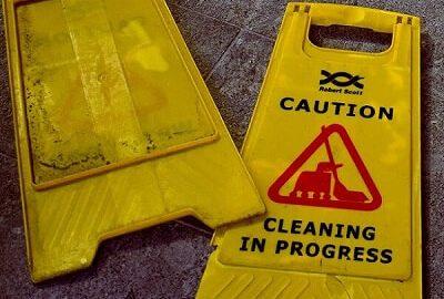 broken wet floor sign